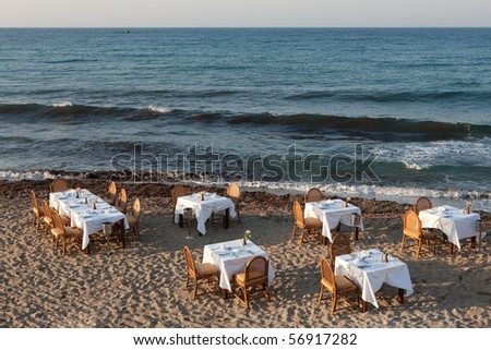 Romantic restaurant setting on a beach