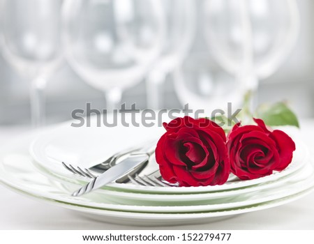 Romantic restaurant table setting for two with roses plates and cutlery #152279477
