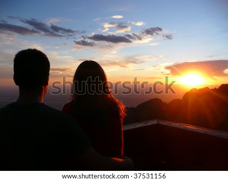 Romantic scene of a couple at sunset