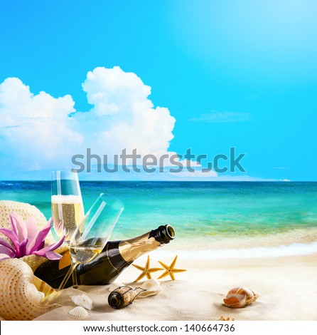 Romantic Sea Beach. Wine Glasses And Champagne Bottle On Sand