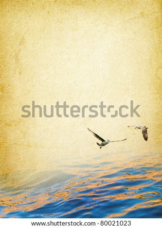 Romantic seascape - surface of sea and two seagulls above the water. Nautical vintage background - marine travel in retro style.
