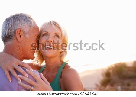 Romantic Senior Couple in love at sunset - stock photo