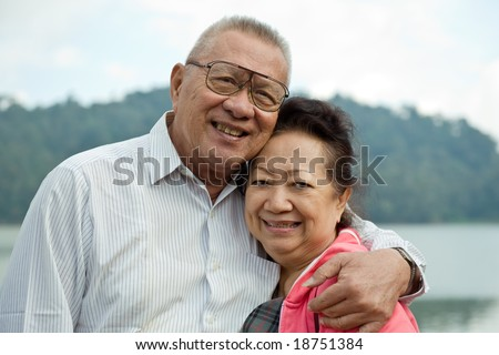 romantic senior couple on lake