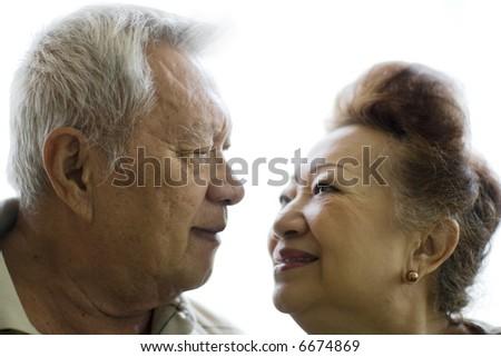romantic senior couple on white background