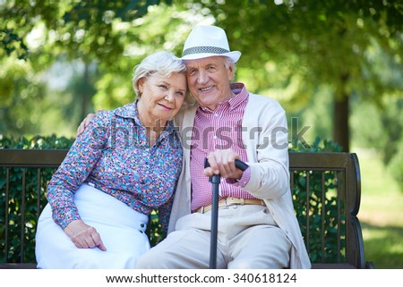 Romantic senior couple relaxed on the park bench #340618124