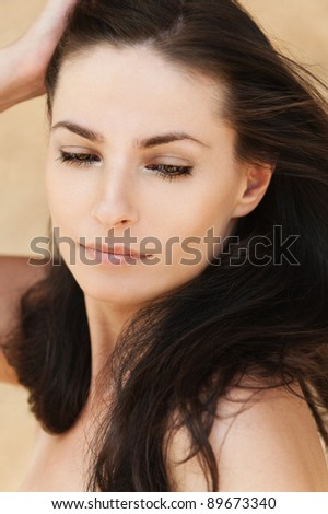 romantic sexy beautiful woman holds hair arm