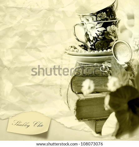 Romantic Shabby chic background with Old Books , pocket watch and cups