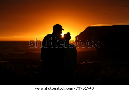 Romantic silhouette at sunset - stock photo