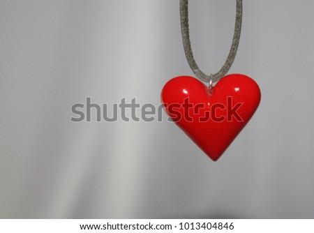 Romantic simple heart pendant shape detail with empty background, love copy space. #1013404846