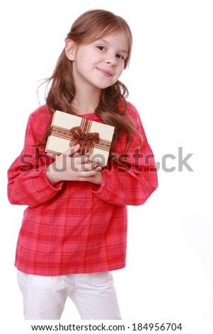 romantic smiling girl holding present over white background