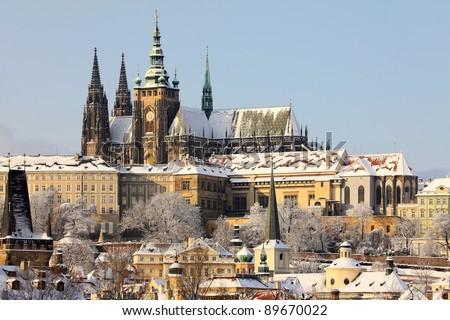 Romantic Snowy Prague gothic Castle above the River Vltava in the sunny Day, Czech Republic