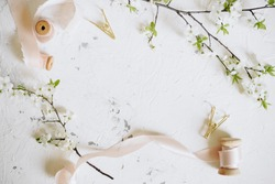 Romantic spring mock up with femininne details vintage pink ribbons and blooming branches