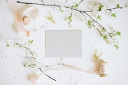Romantic spring mock up with grey envelope and femininne details
