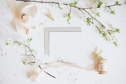 Romantic spring mock up with white card and envelope and femininne details
