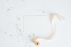 Romantic spring mock up with white card and femininne details