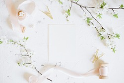 Romantic spring mock up with white card and femininne vintage pink ribbons