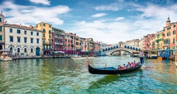 Romantic spring scene of famous Canal Grande. Colorful morning panorama with Rialto Bridge. Picturesque cityscape of  Venice, Italy, Europe. Traveling concept background.