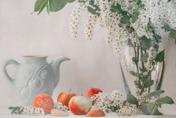 Romantic still life with apples and peaches, naturemorte in white light tones
