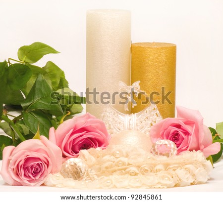 Romantic still-life with white candle and roses