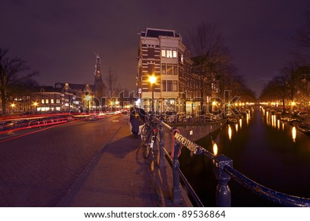 Romantic street view in Amsterdam city at night in the Netherlands