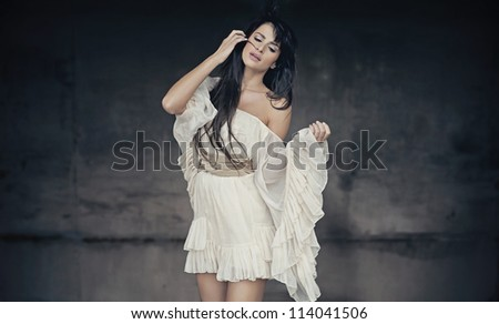 Romantic style photo of a beautiful brunette