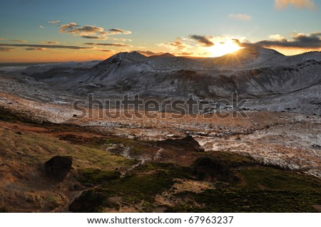 Romantic sunset and snow covered valley, Iceland
