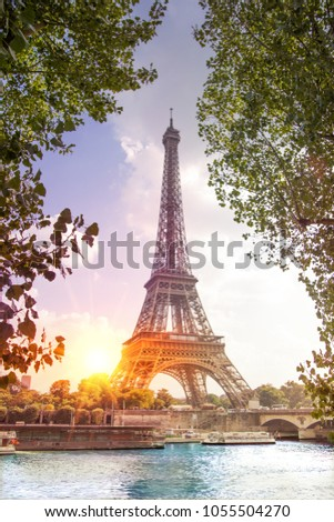 Romantic sunset background. Eiffel Tower with boats on Seine river in Paris, France. #1055504270
