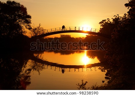 Romantic sunset moment on bridge in Park Ibirapuera Sao Paulo Brazil.
