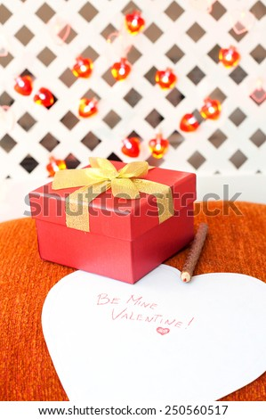 Romantic surprise. Valentine\'s day gift box with love message. Indoors closeup.