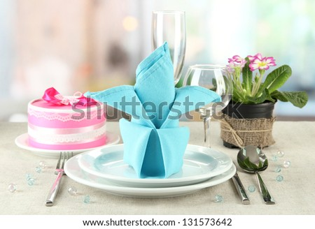 Romantic table serving on bright background - stock photo