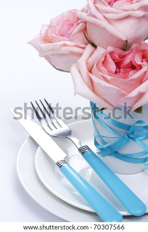 Romantic table setting with roses
