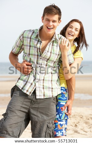 stock photo : Romantic Teenage Couple Embracing On Beach