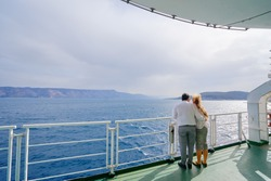 Romantic vacation. Young loving couple enjoying view on cruise ship deck. Sailing the sea.