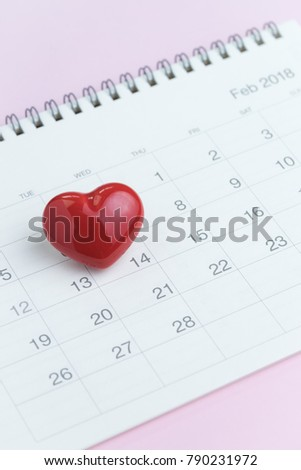Romantic Valentines day concept as clean calendar with cute red heart shape on 14th February on pink background. #790231972