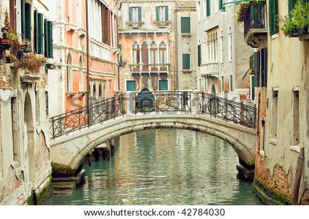 Romantic Venetian bridge in residential part of Venice - stock photo