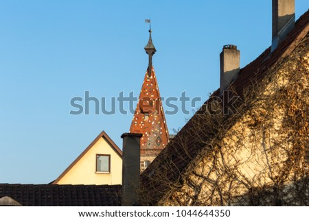 romantic view at church roof in a historical city schwaebisch gmuend in south germany #1044644350