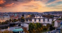 Romantic view to the cityscape of Prague, Czech Republic, with the various bridges over Vltava River and the gothic architecture of the old town during dusk