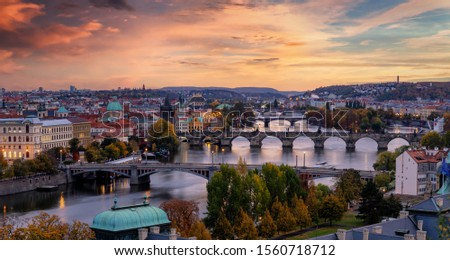 Romantic view to the cityscape of Prague, Czech Republic, with the various bridges over Vltava River and the gothic architecture of the old town during dusk Stock photo ©