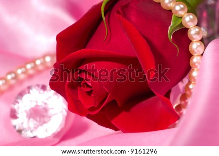 Romantic way to present a jewelry with beautiful rose on Valentine day.