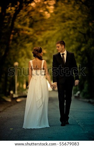 Romantic wedding couple having fun together outdoor in nature - stock photo