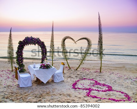 Romantic wedding dinner on a tropical beach in Thailand
