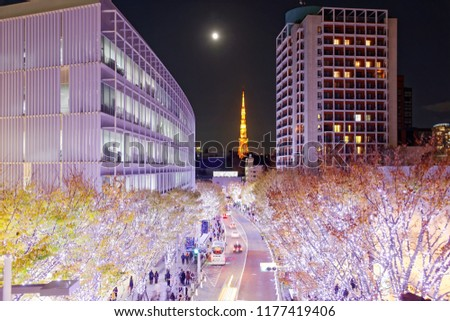 Romantic Winter Illumination Display in Christmas season in Keyakizaka, viewed from Roppongi Hills, with illuminated buildings & trees by the street and the moon rising above Tokyo Tower in background #1177419406
