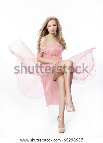romantic woman in pink dress on white background