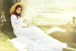 Romantic Woman Victorian Retro Style, Fashion Model in White Dress Wide Brim Hat Reading Book, Outdoor Beauty Portrait