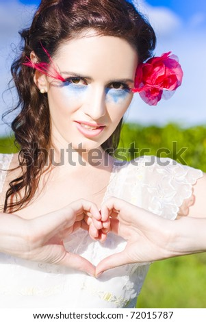 Romantic Woman With Beautiful Makeup And Hair Rose Shows A Sign Of True Love By Creating A Heart With Her Hands In A Positive Loving And Tender Outdoor Gesture