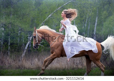 Romantic young beautiful girl galloping on a horse