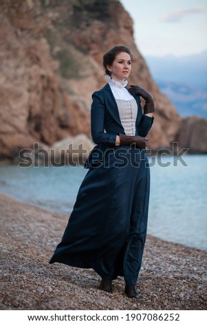 Romantic young beautiful lady wearing victorian dress looking  at the sea. Vintage style. Steampunk concept Сток-фото ©