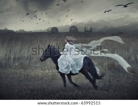Romantic young beauty riding a horse