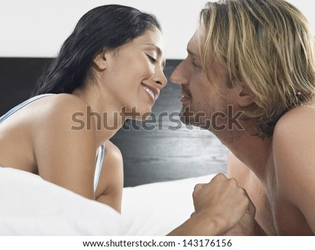 kissing couples romantic in bed hugging kiss in bed division of global affairs 3550