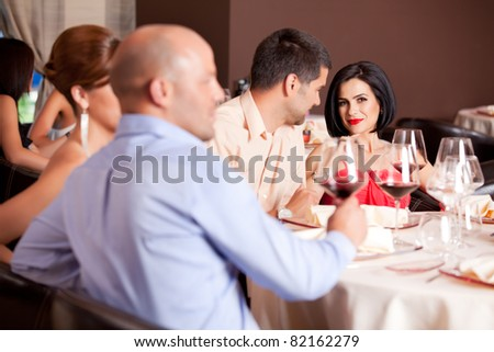 romantic young couple at restaurant table